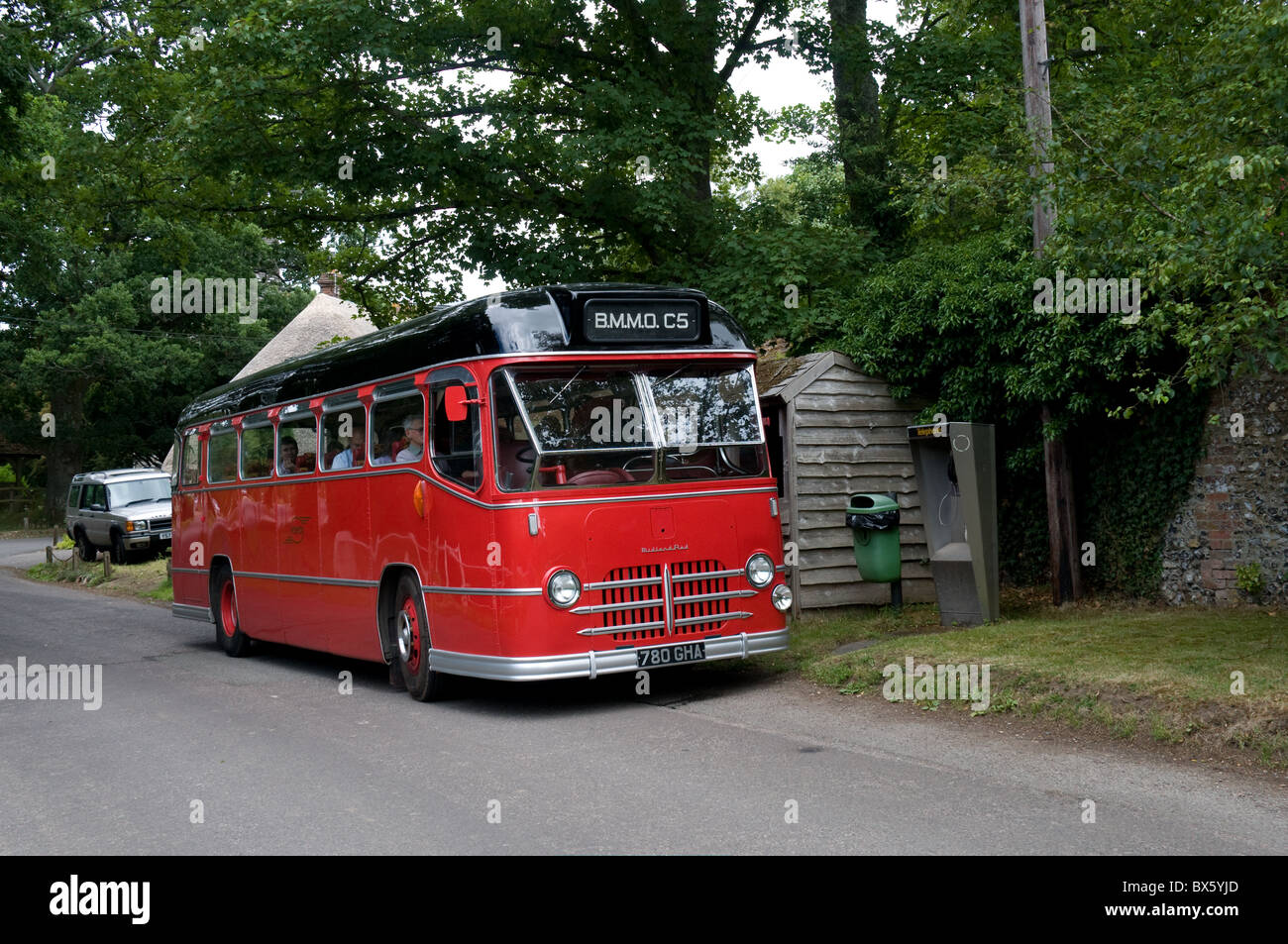 A preserved Midland Red C5 coach takes a break in countryside while giving a ride to attendees of a Bus Rally. Stock Photo