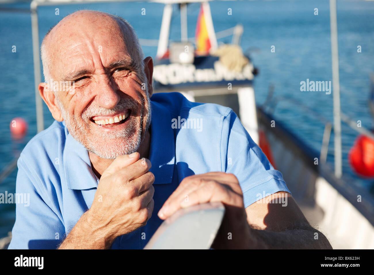 Fisherman on fishing boat - Stock Image