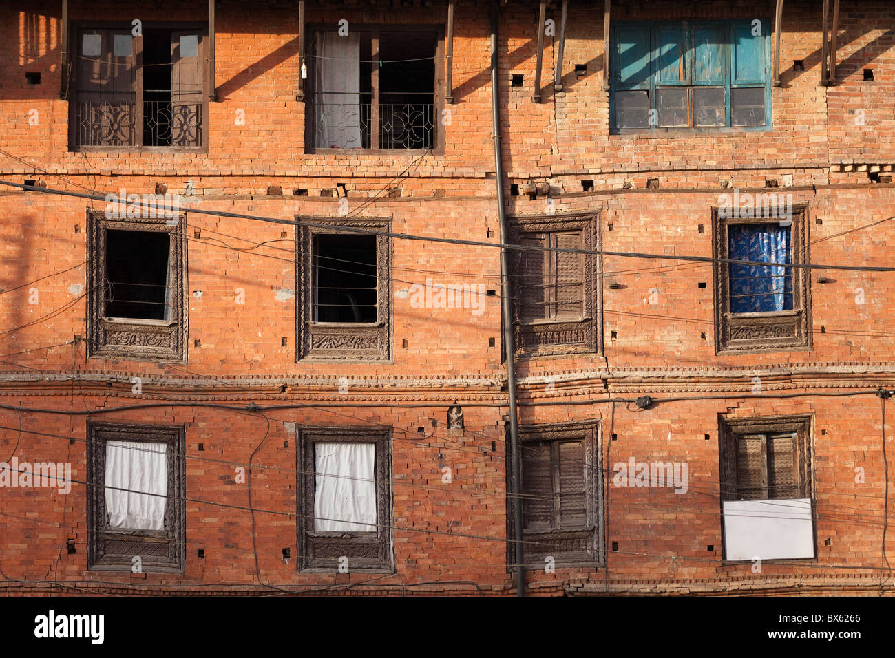 ancient building crooked facade in Bhaktapur, Nepal - Stock Image