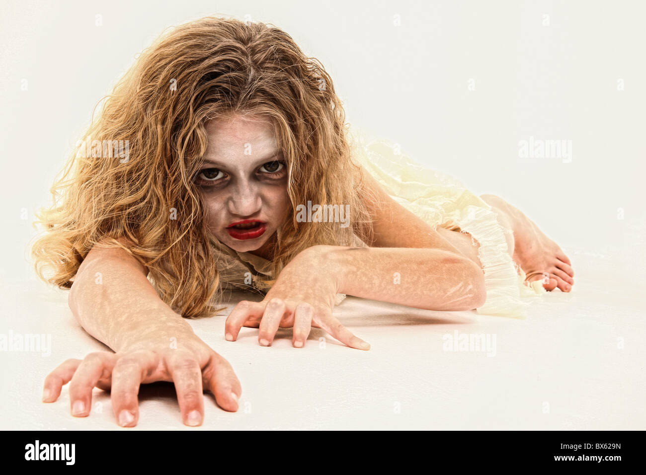 Adorable 7 Year Old Girl In Zombie Costume Over White Background