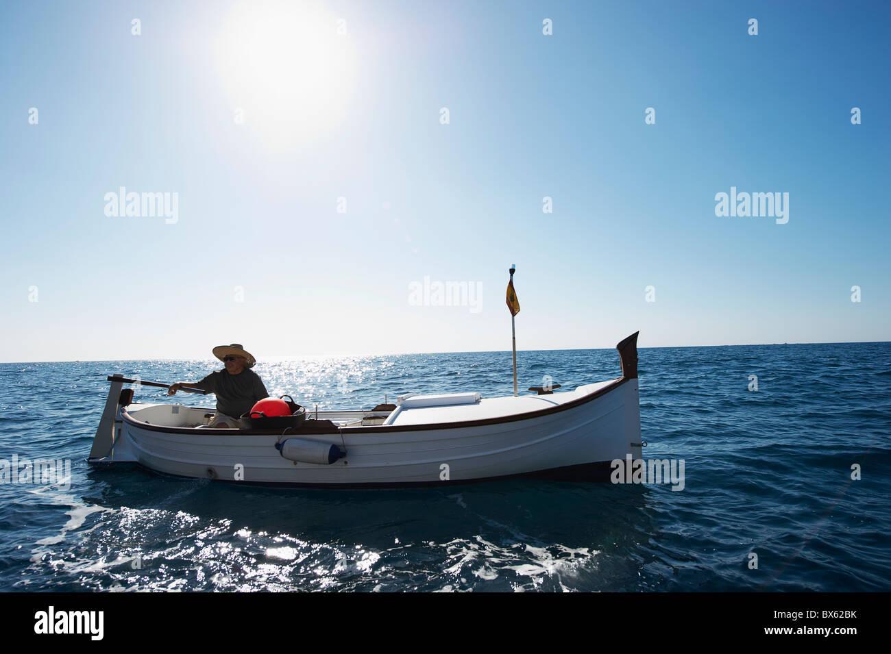 Fisherman on fishing boat at sea - Stock Image