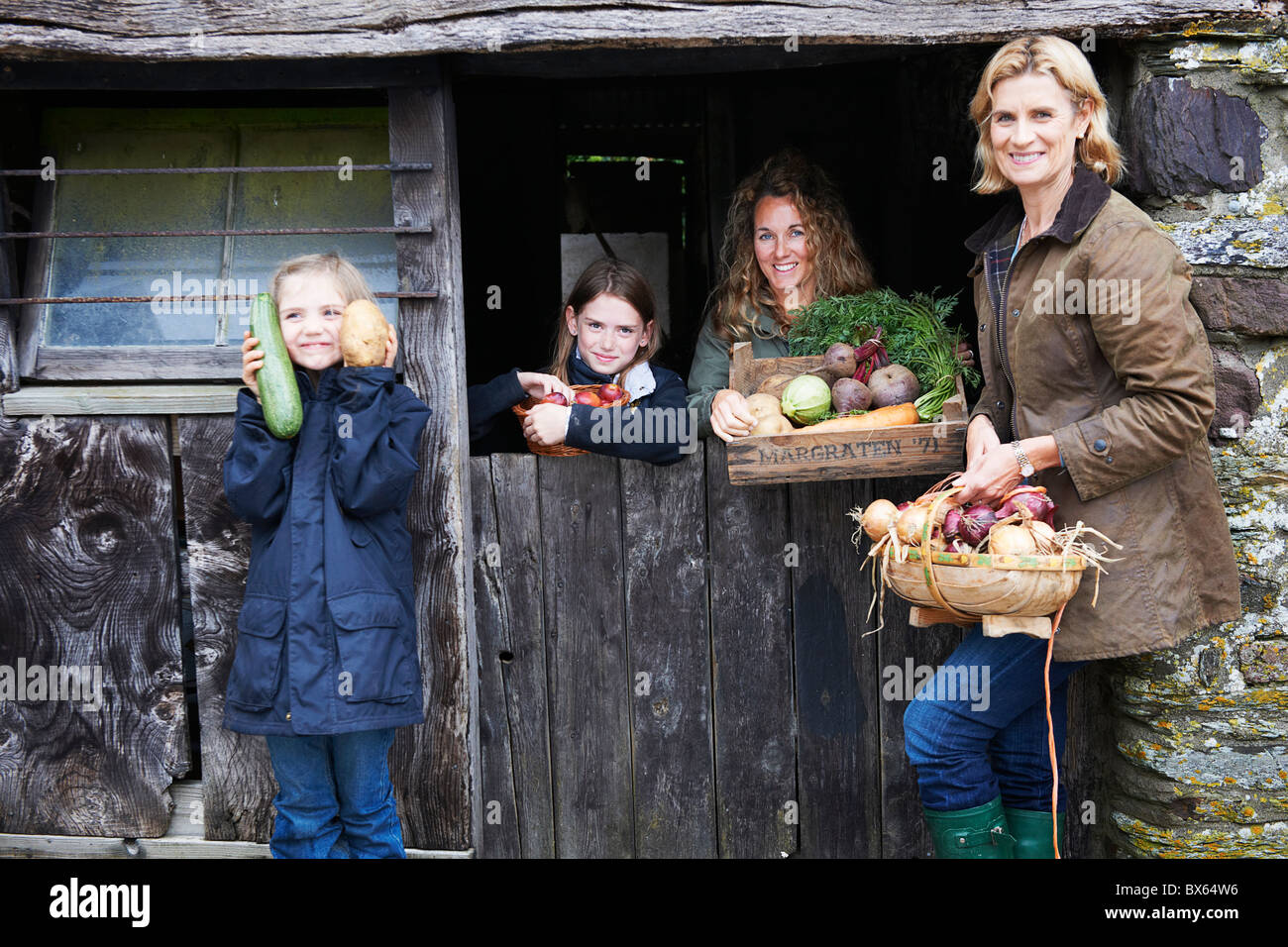 Family with fresh vegetables - Stock Image