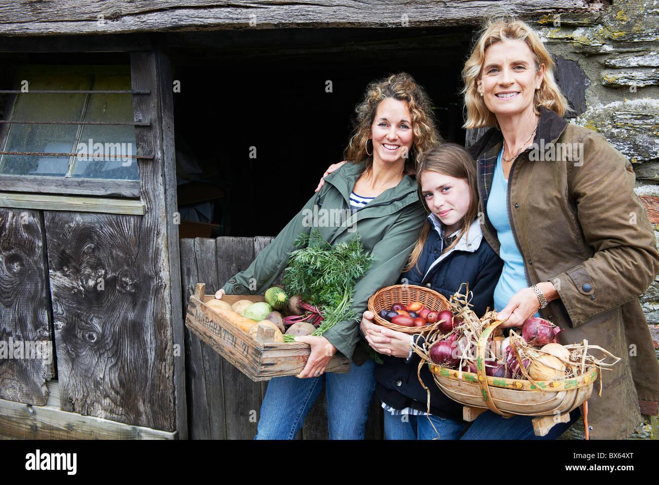 Family holding vegetables Stock Photo
