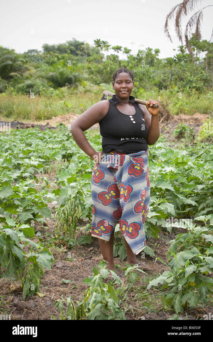 A female farmer stands in her field in Kakata, Liberia, West Africa. - Stock Image
