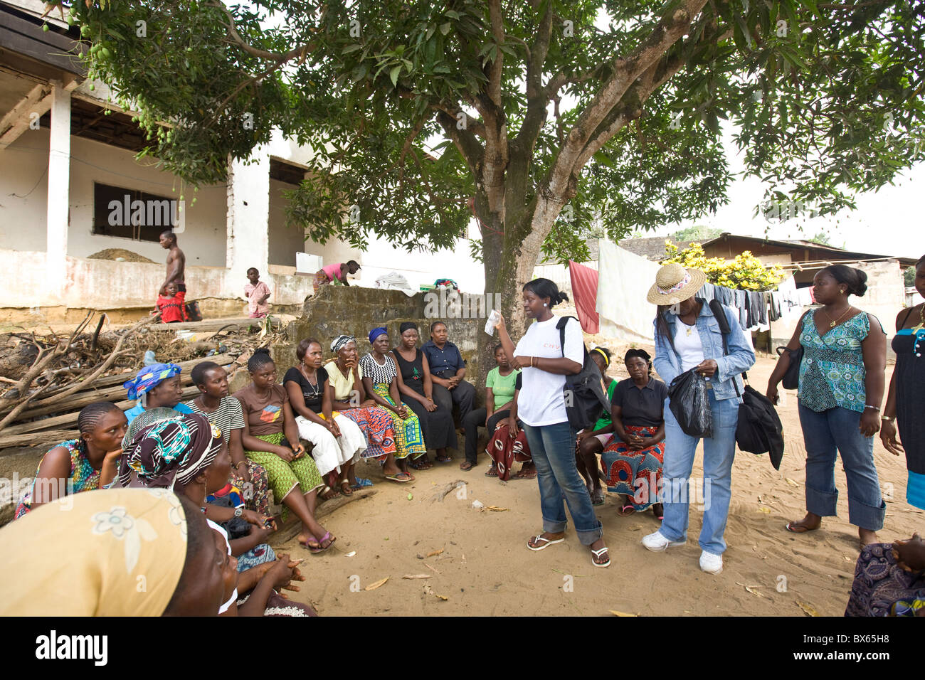 A community health awareness group meets in a neighborhood in Monrovia, Liberia, West Africa. - Stock Image