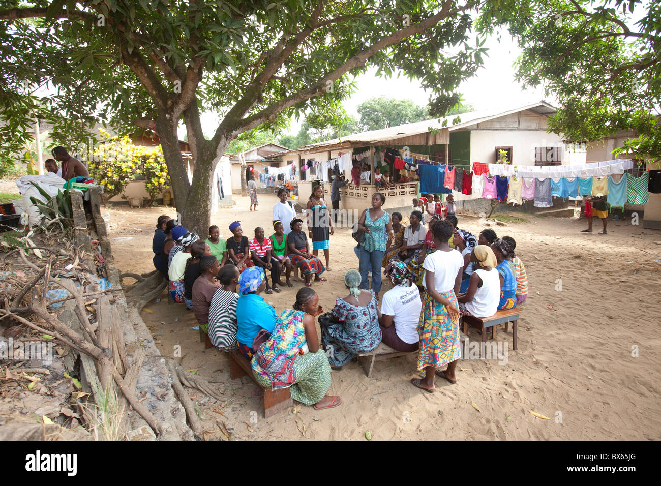 A women's community group meets in a neighborhood in Monrovia, Liberia, West Africa. - Stock Image