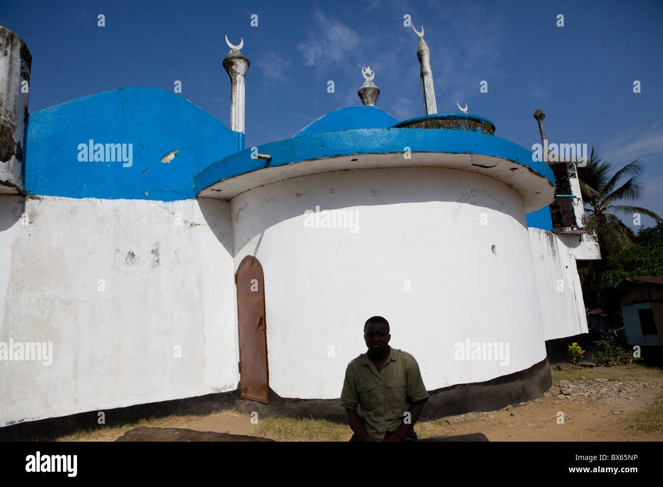 A man sits outside a mosque in Matadi, Monrovia, Liberia, West Africa. - Stock Image