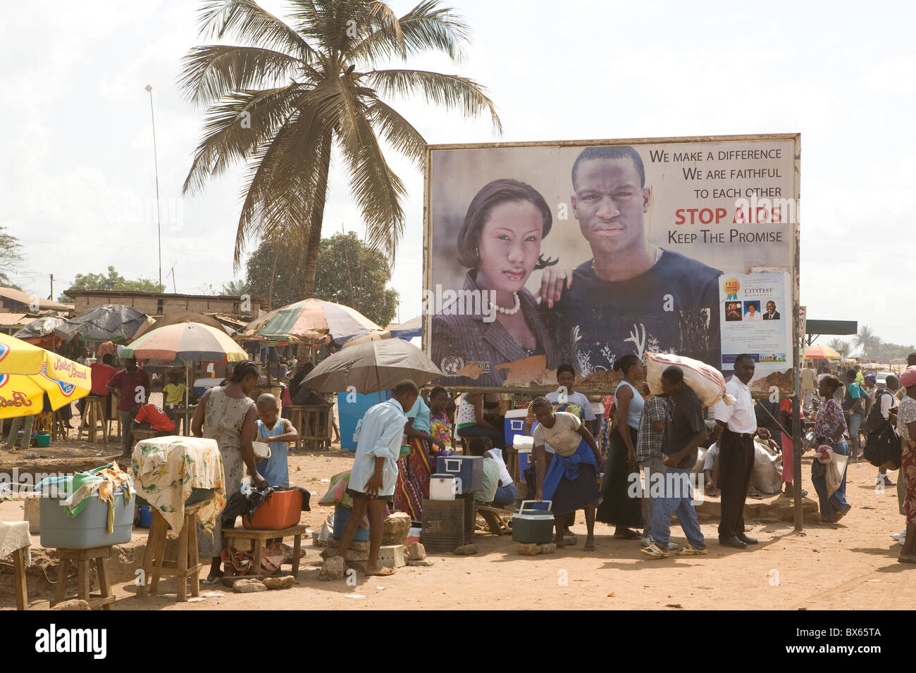 A public service advertisement warns of HIV/AIDS in Monrovia, Liberia, West Africa. - Stock Image