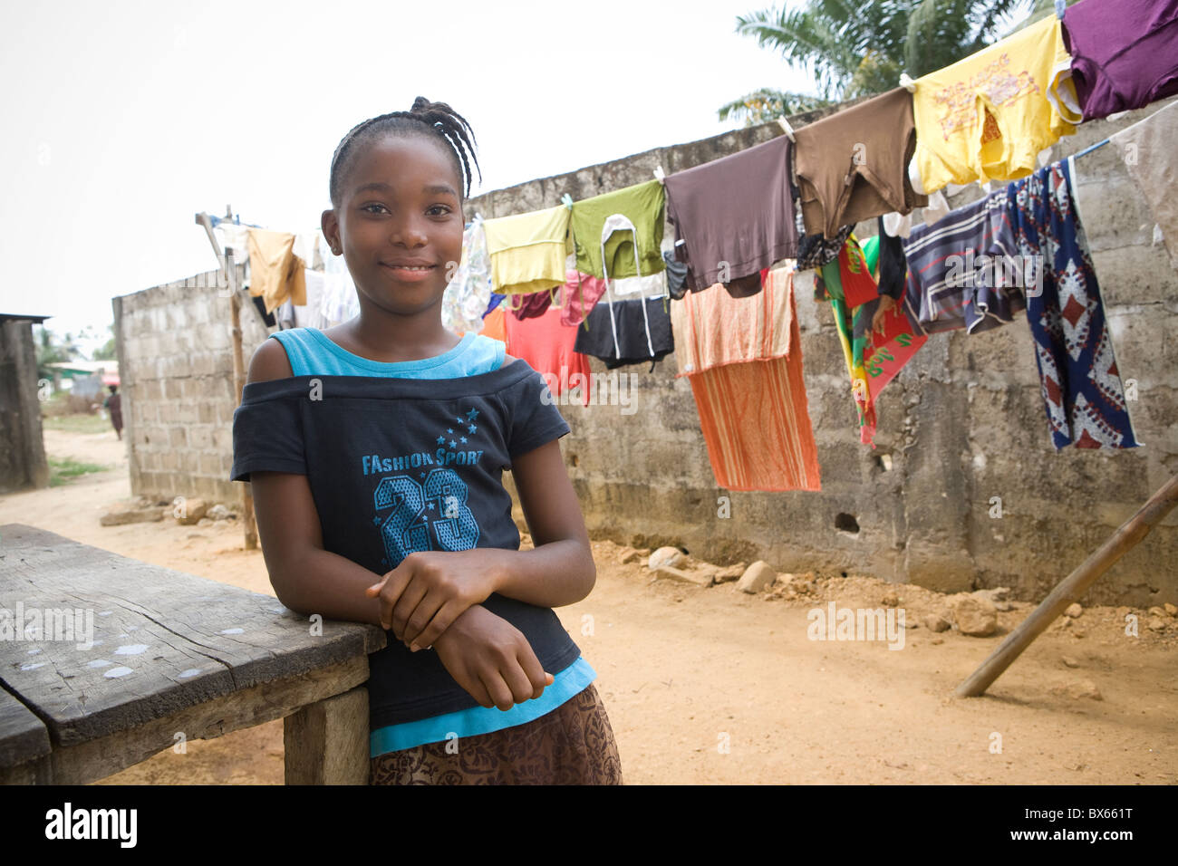 A young girl stands outside her house in Monrovia, Liberia, West Africa. - Stock Image