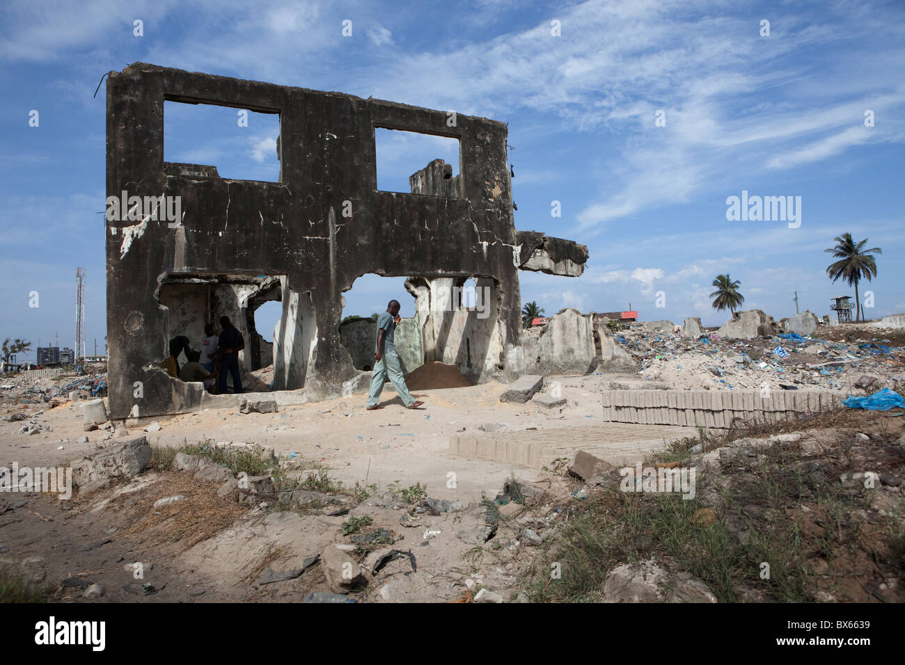 city scene along oceanfront showing war damaged buildings stock