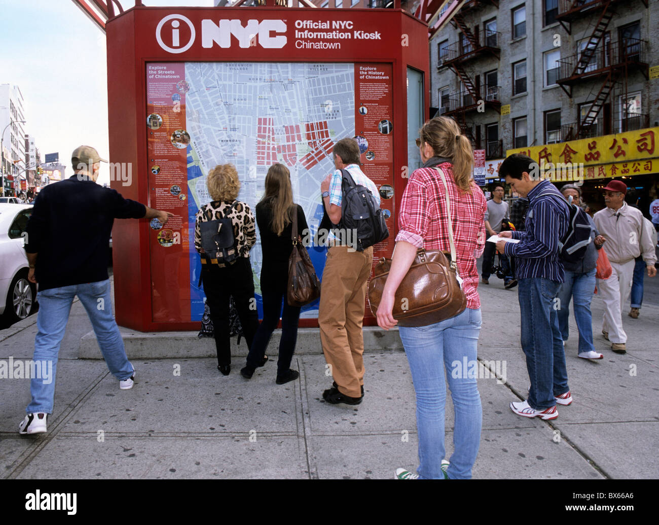 USA New York City Canal Street Chinatown Information Kiosk Lower East Side Manhattan  Street Scene. Tourists looking at a map b2e6493dc96ea