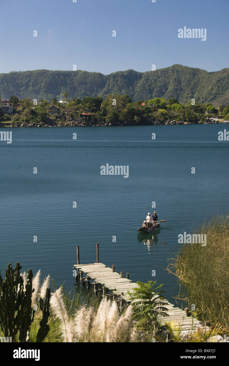 Lake Atitlan with fishermen in a small boat, near Santiago Atitlan. Guatemala, Central America Stock Photo
