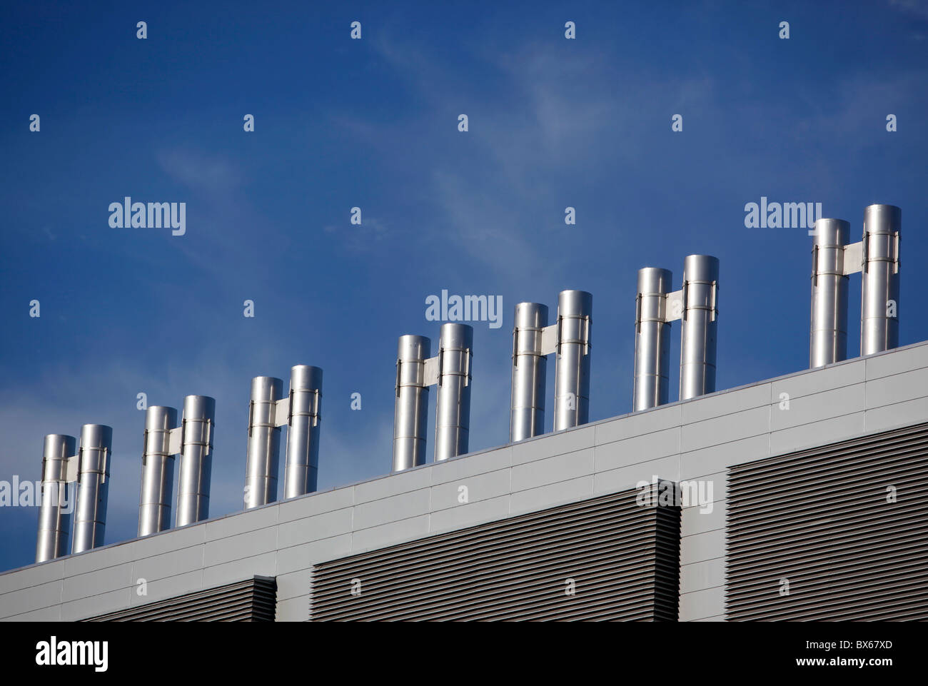 stainless steel vents on top of an building - Stock Image