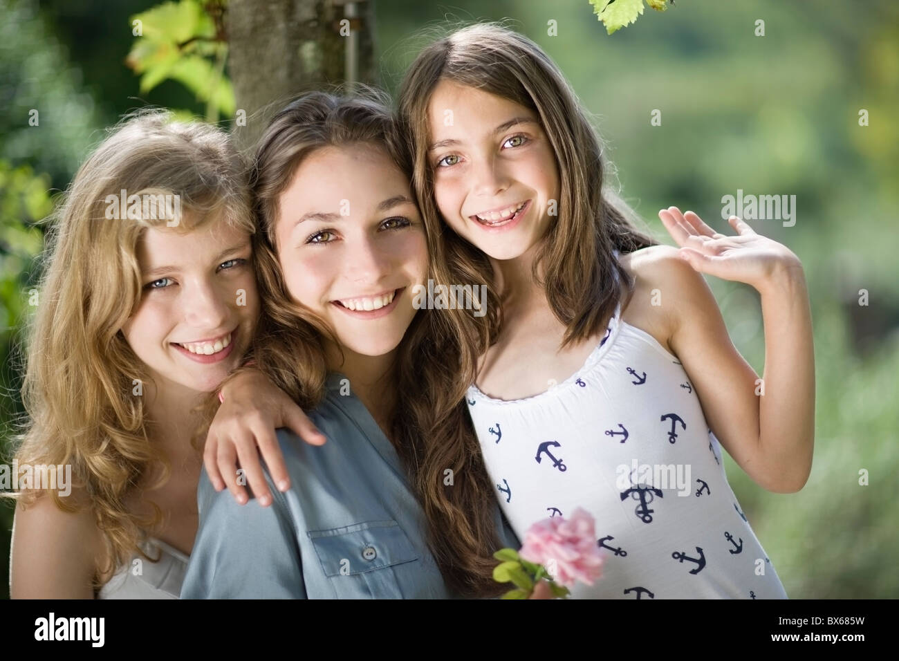 Three girls hugging each other Stock Photo