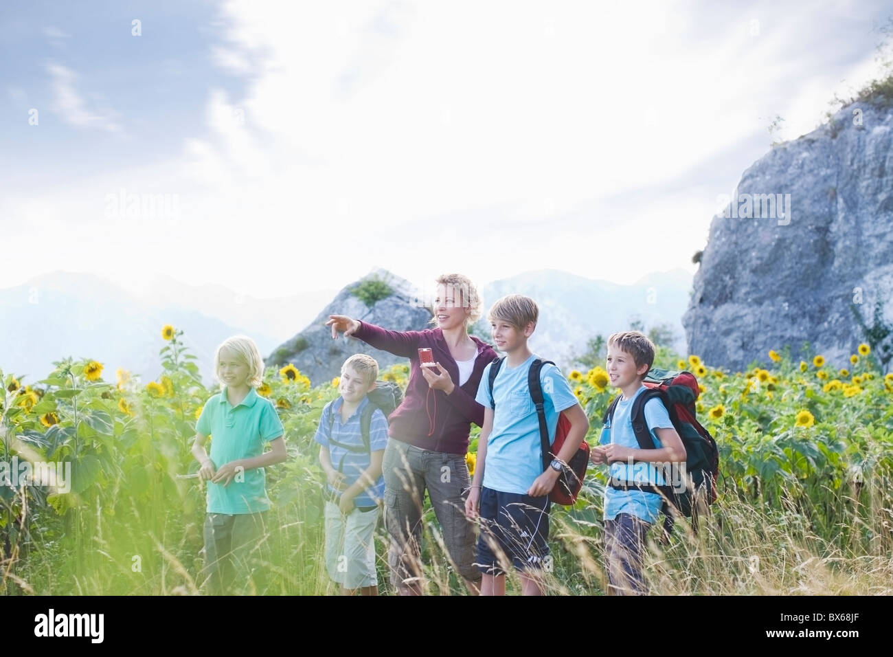 Woman with boys in nature - Stock Image