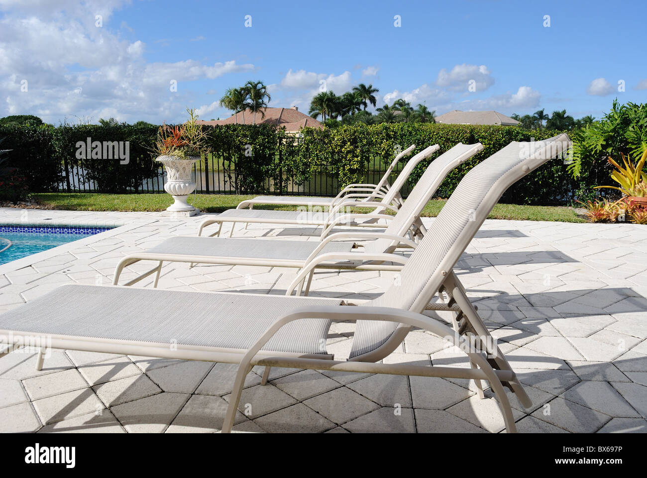 Poolside Lounge Chairs - Stock Image