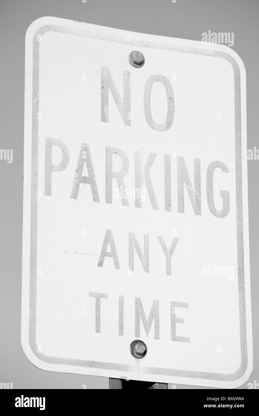 No parking any time faded sign - Stock Image