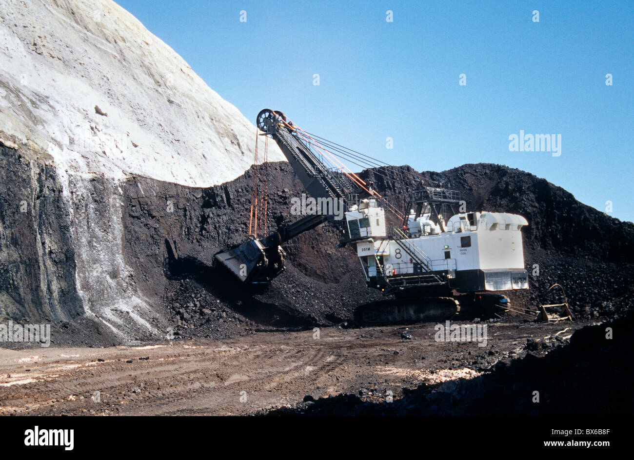 Coal, surface mine, P & H  Electric shovel excavating from coal seam, - Stock Image