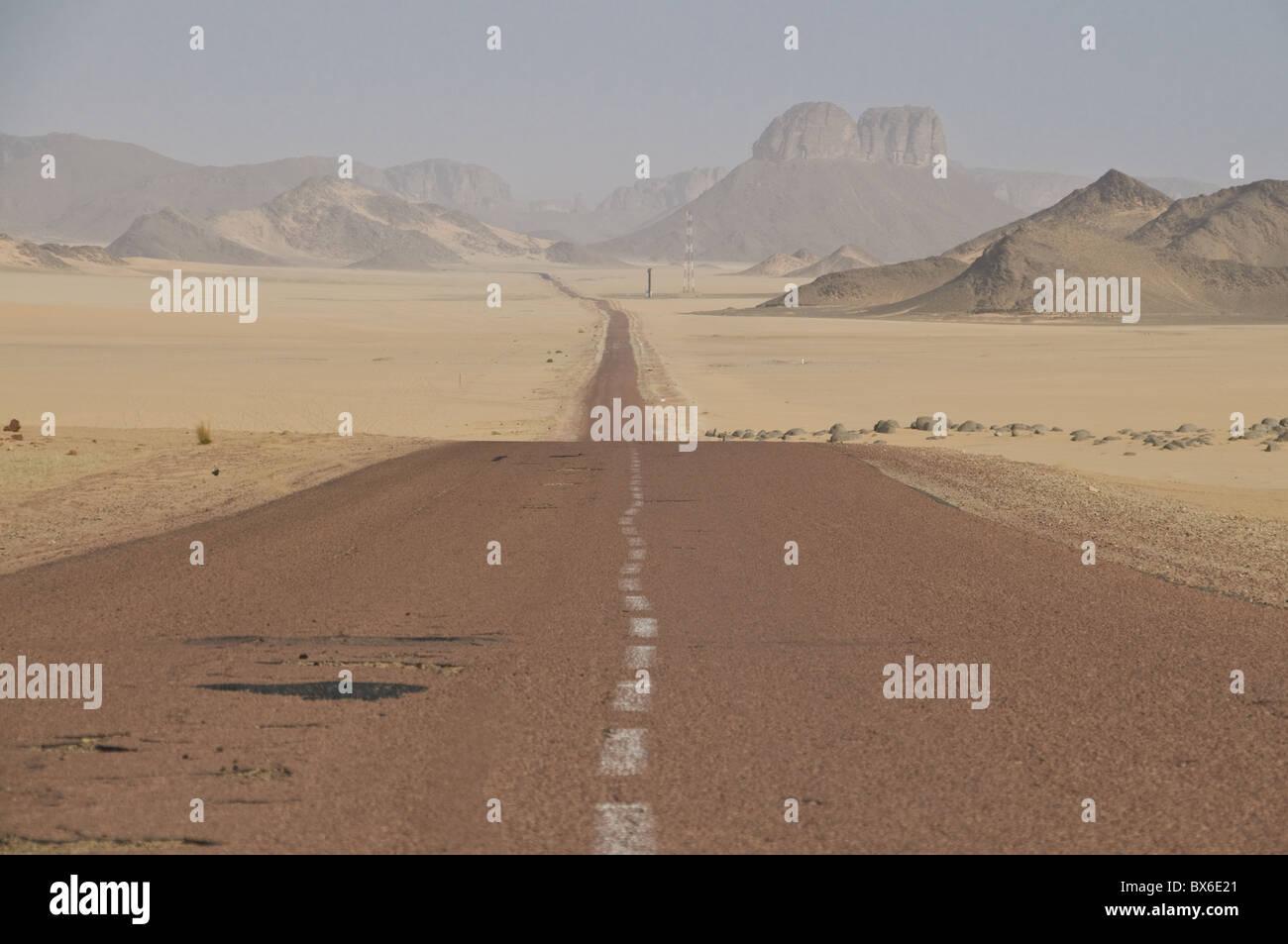 Long straight road in the Sahara Desert, Algeria, North Africa, Africa Stock Photo