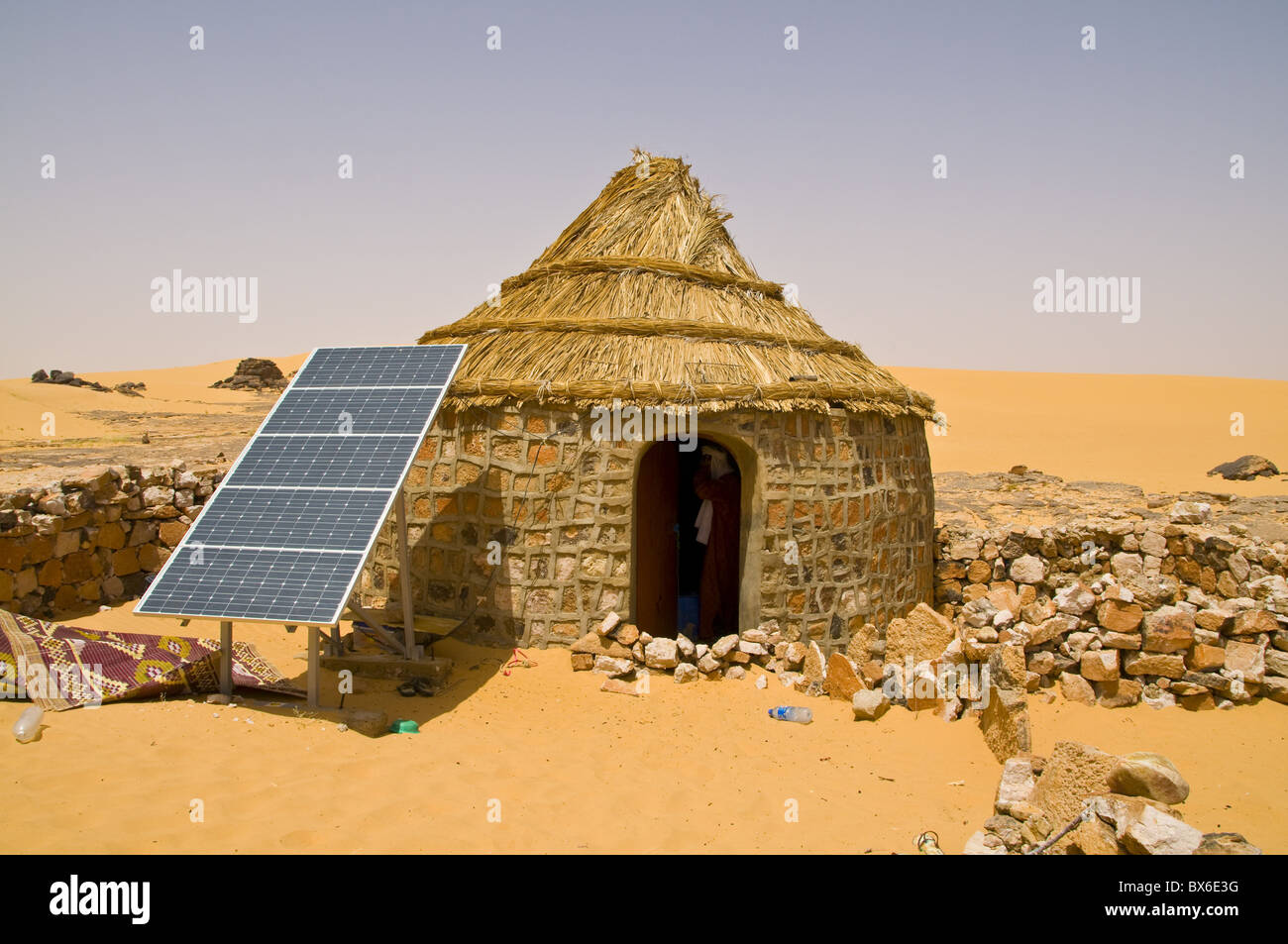Traditional House With A Solar Panel In The Sahara Desert