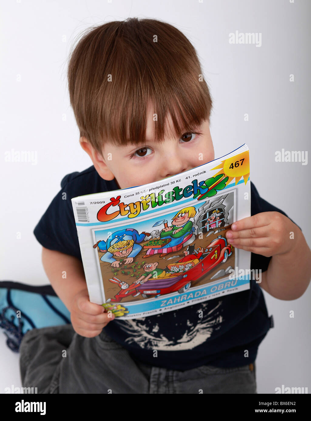 A child with the comics magazine Ctyrlistek (Four-leaf clover). (CTK Photo/Martin Sterba) - Stock Image