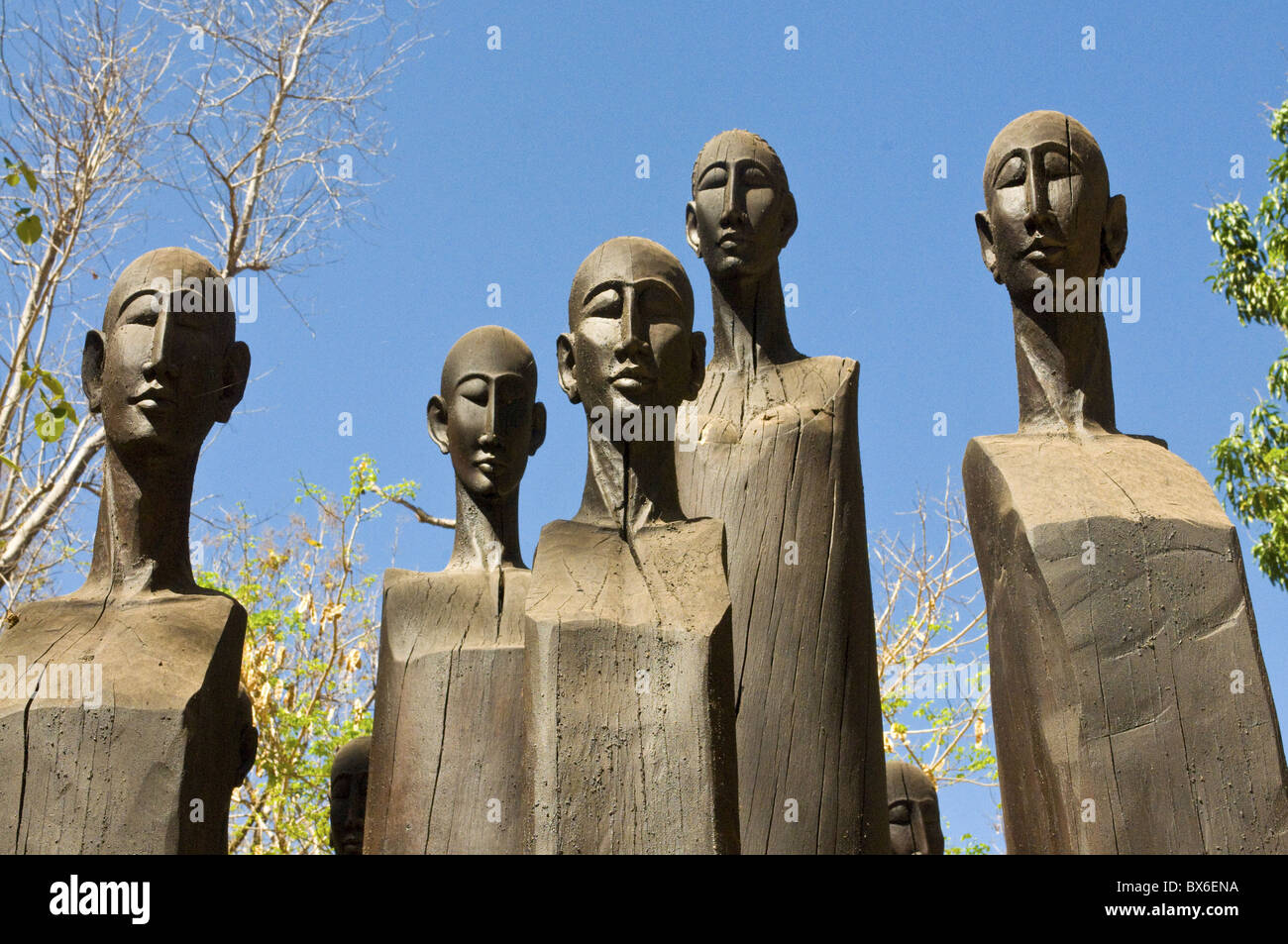 Wooden statues at the entrance of the Ankarafantsika National Park, Madagascar, Africa - Stock Image