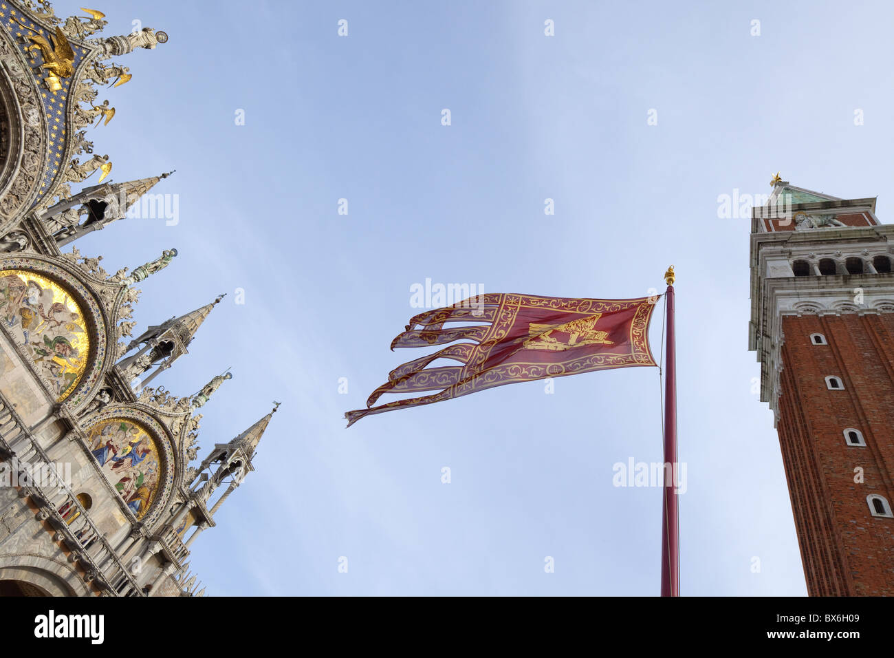 Campanile and Basilica San Marco, St. Mark's Square, with Venetian flag, Venice, UNESCO World Heritage Site, - Stock Image