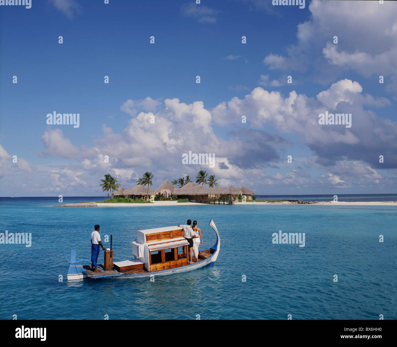 Couple ariving at the Four Seasons Spa in the Maldives, Indian Ocean, Asia - Stock Image