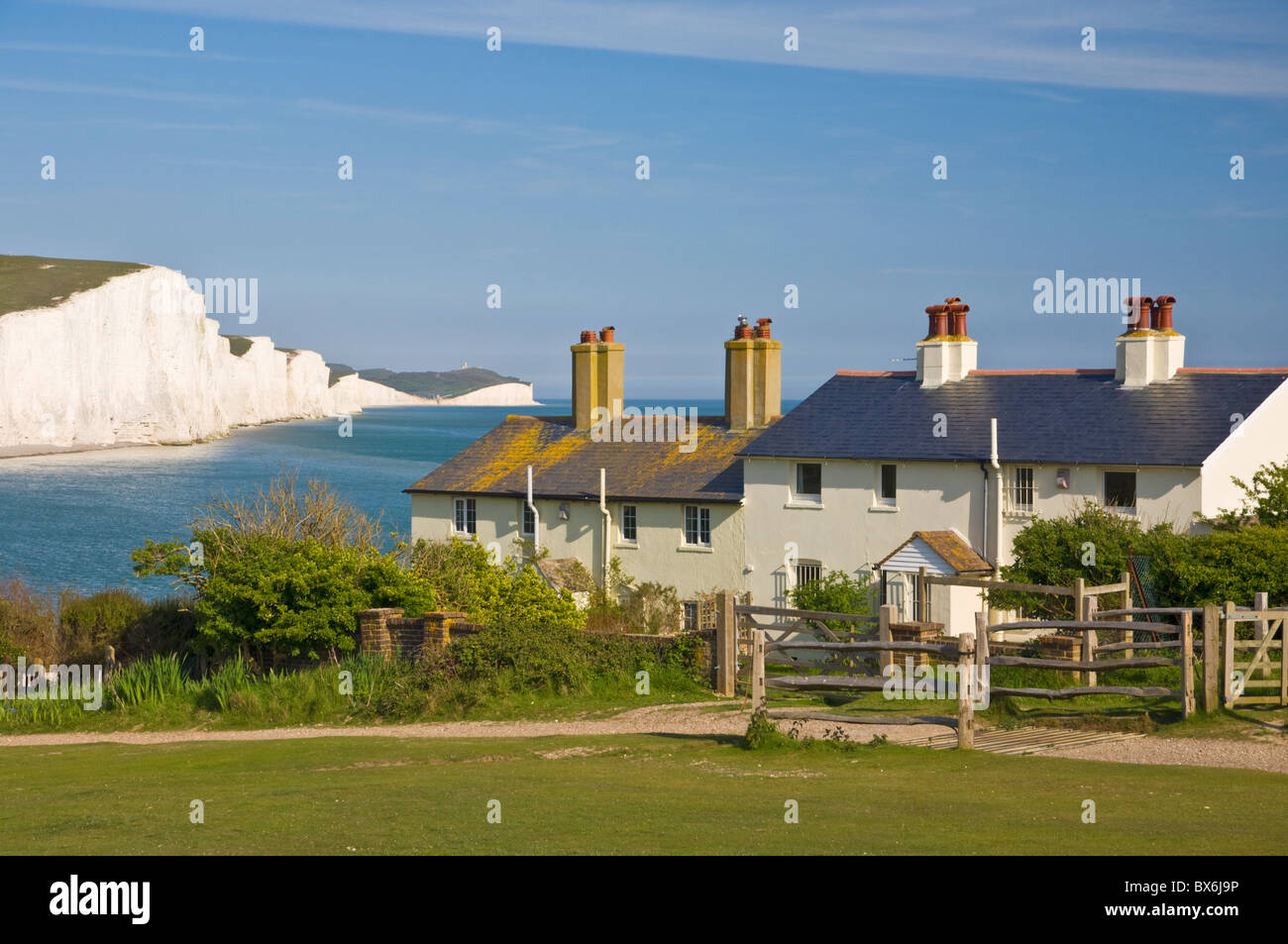 View of The Seven Sisters cliffs, the coastguard cottages on Seaford Head, South Downs National Park, East Sussex, Stock Photo