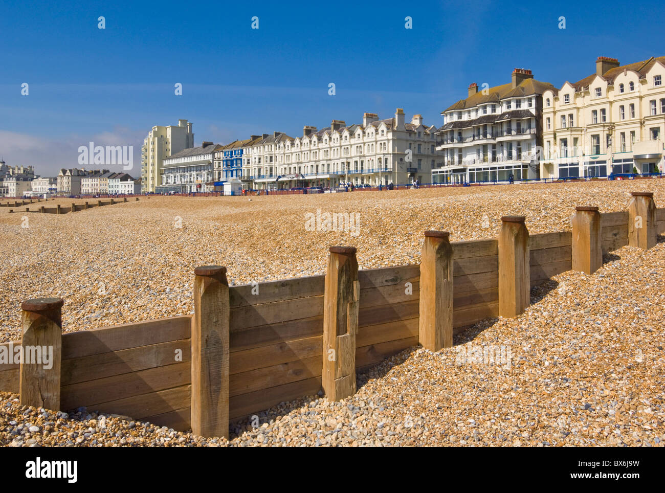 Pebble beach and groynes, hotels on the seafront promenade, Eastbourne, East Sussex, England, United Kingdom, Europe - Stock Image