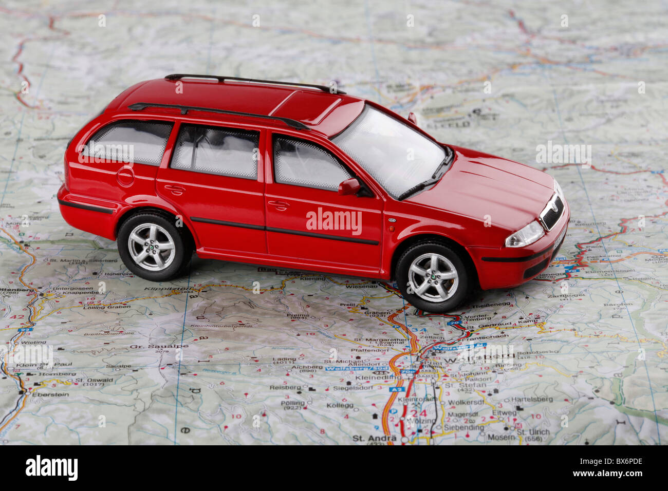 Travelling expenses. A car, model, Skoda Octavia Combi, map. (CTK Photo/Martin Sterba) - Stock Image