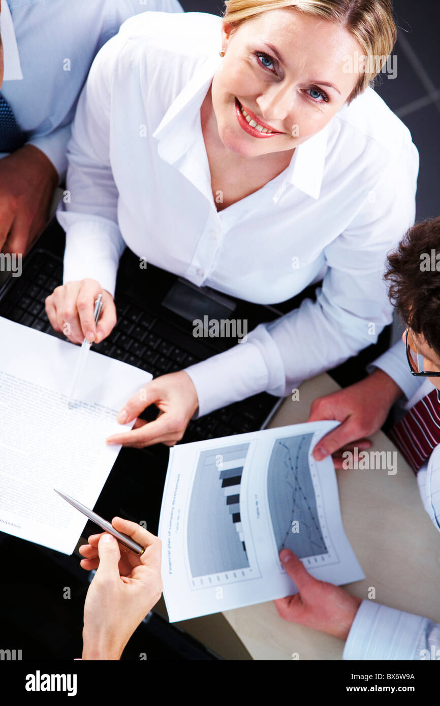 Above view of businesswoman looking at camera during negotiations Stock Photo
