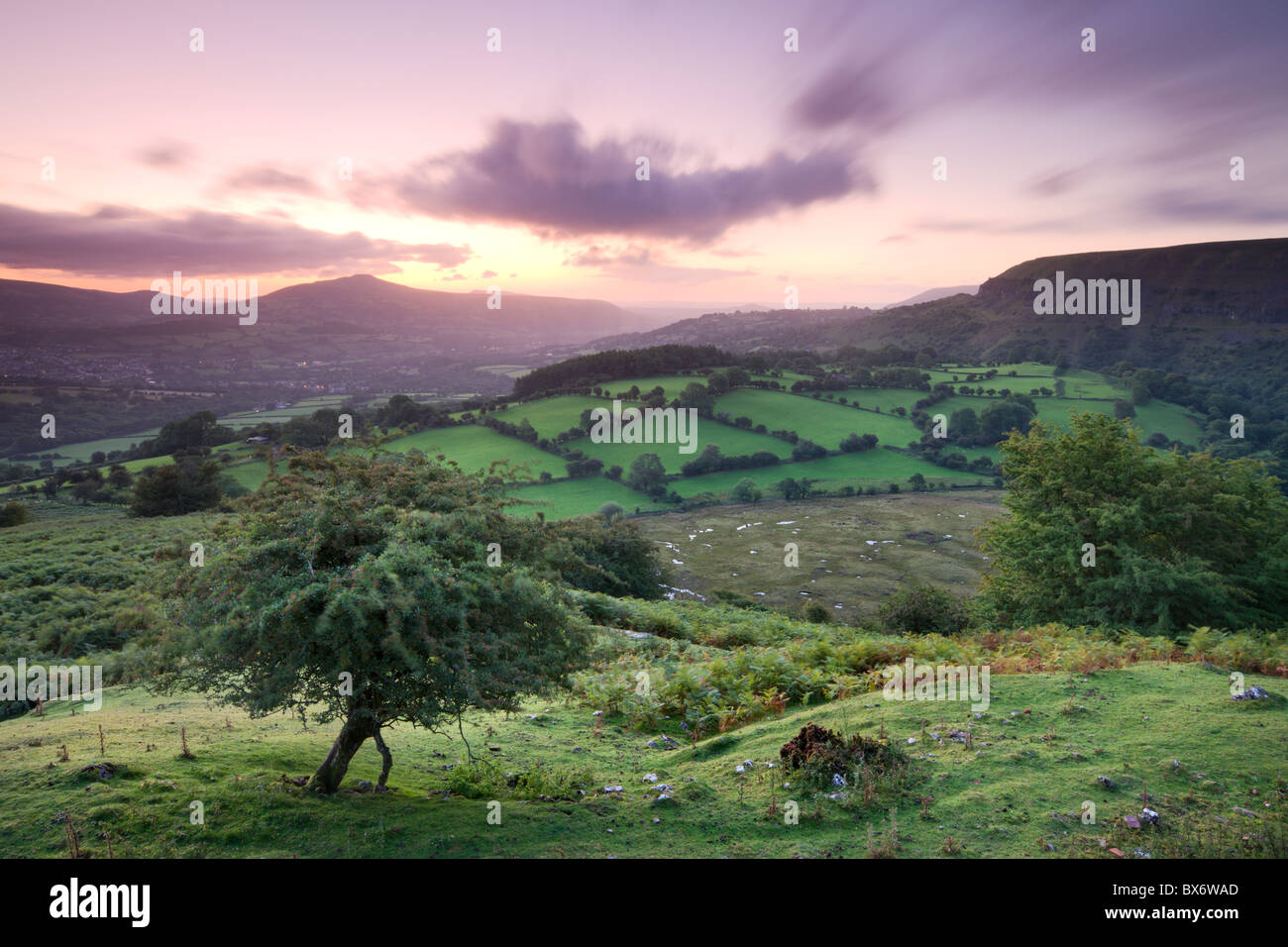 Sunrise over the Sugar Loaf viewed from Craig y Cilau near Llangattock Escarpment, Brecon Beacons National Park, - Stock Image