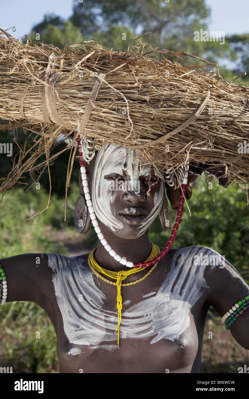 Young Mursi woman, Omo Valley, Ethiopia, Africa - Stock Image