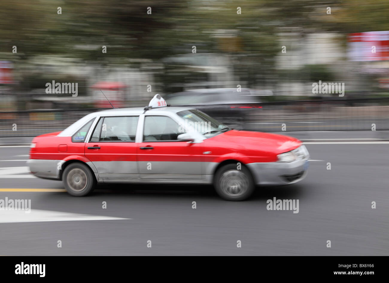 Taxi in the street of Shanghai, China. With motion blur - Stock Image
