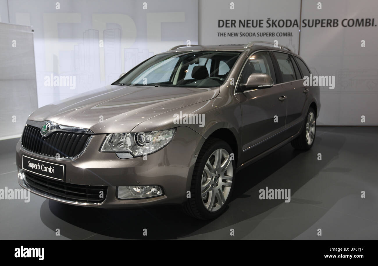 Final touches on a brand new limousine Skoda Superb Combi  on the car maker's stand before it's world premier - Stock Image