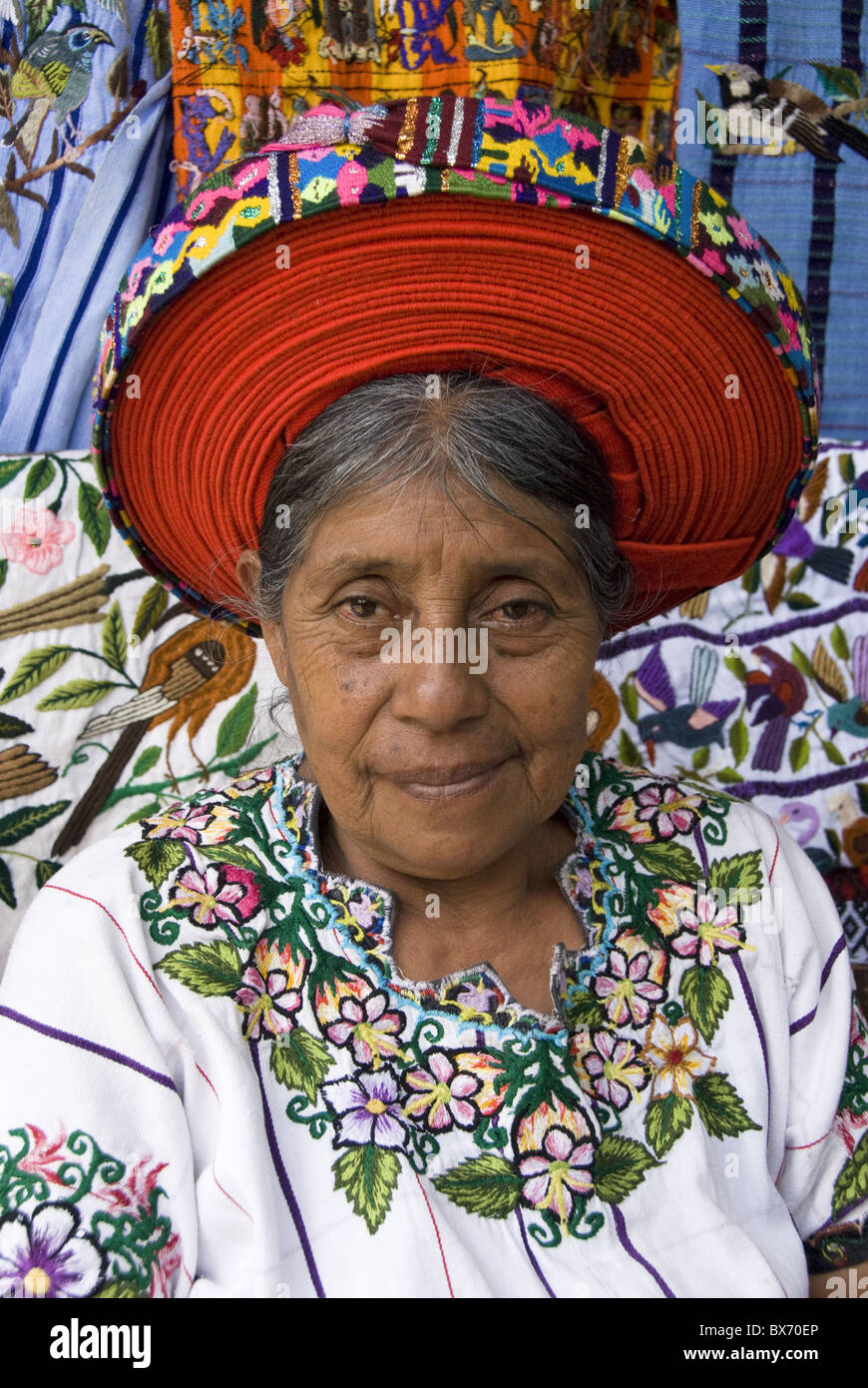 Indigenous Indian woman in traditional blouse (huipiles), with a hat called a xk'ap, Santiago Atitlan, Lake - Stock Image