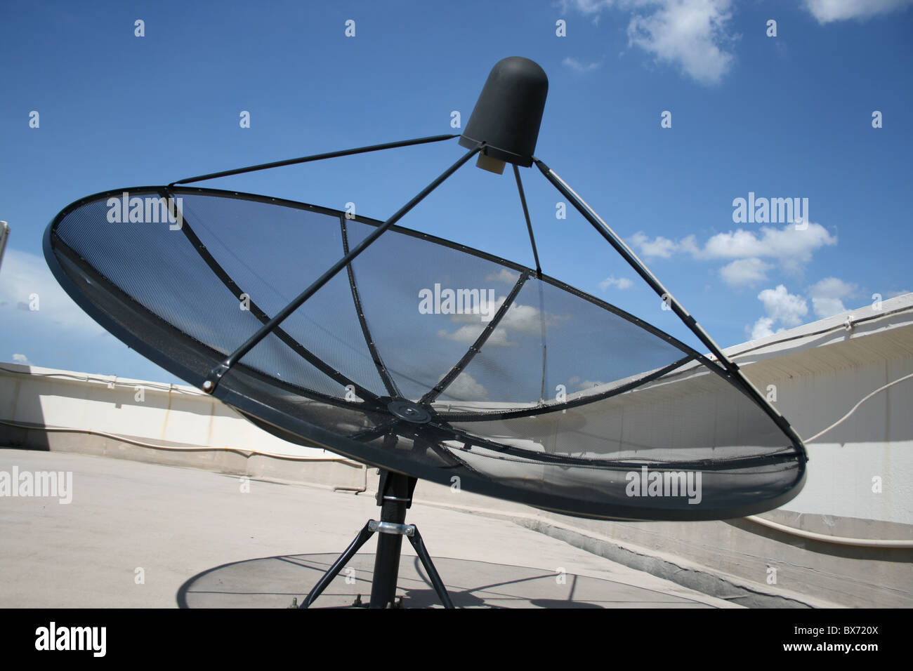 Satellite dish outdoors in Thailand. - Stock Image