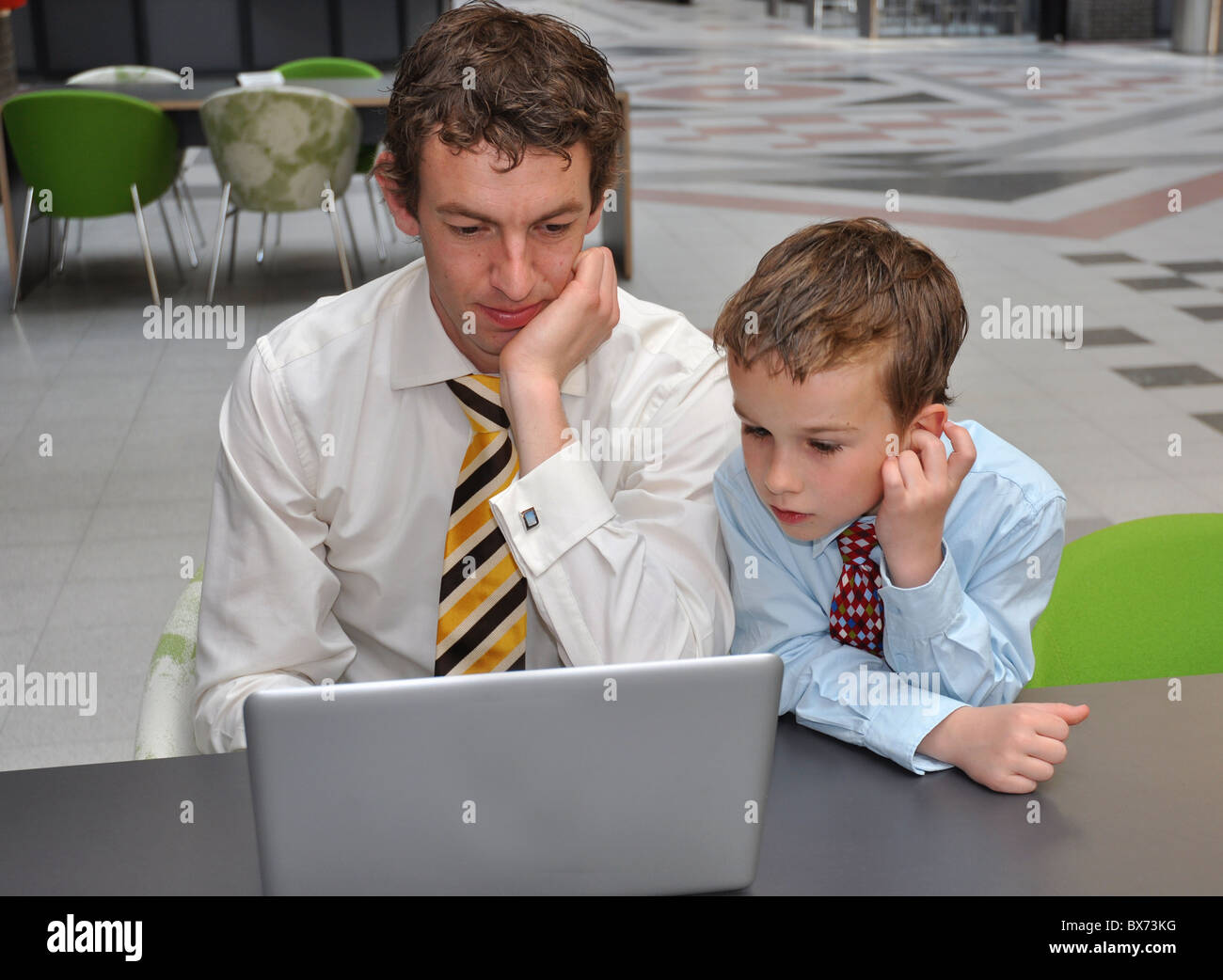 Men preparing presentation for the board - Stock Image