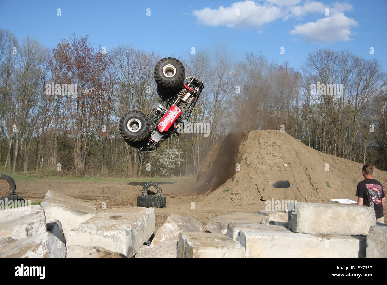 Monster Truck Ghost Ryder attempting a flip at the Vermonster 4x4 rally in Bradford, Vermont - Stock Image