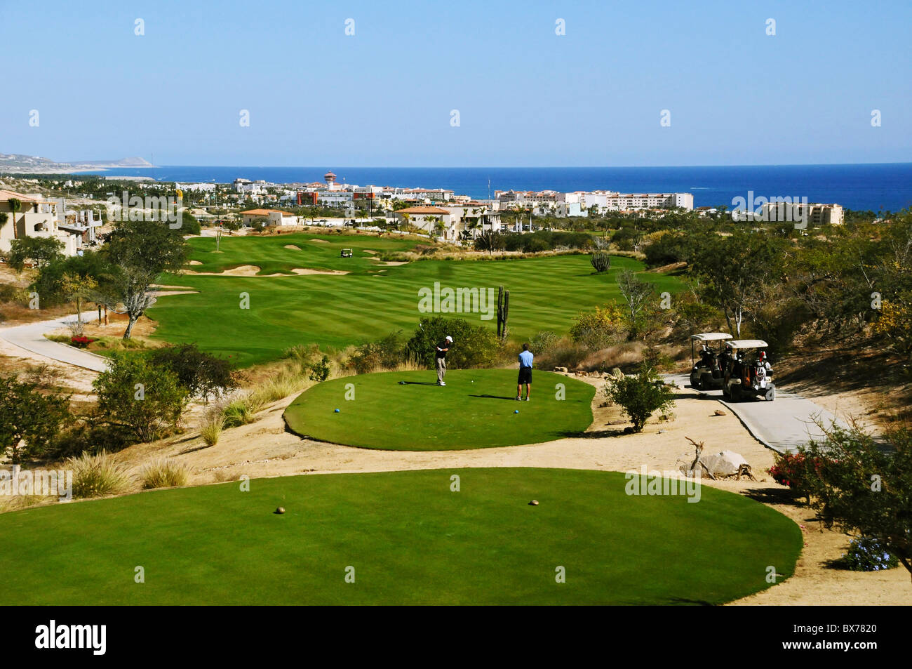 18th hole at Club Campestre Golf Course with town of San Jose del Cabo and Pacific Ocean below in Baja, Mexico Stock Photo