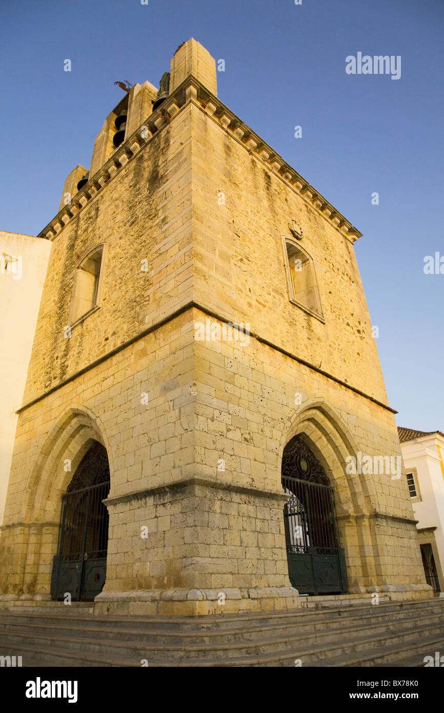 The fortress like stone tower of medieval Faro Cathedral (Largo da Se) in Faro, Algarve, Portugal, Europe Stock Photo