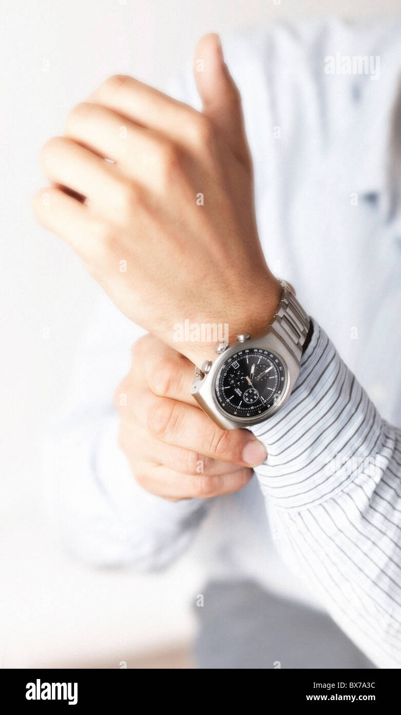 A man with watches on the the left hand. (CTK Photo/Josef Horazny, Martin Sterba) - Stock Image