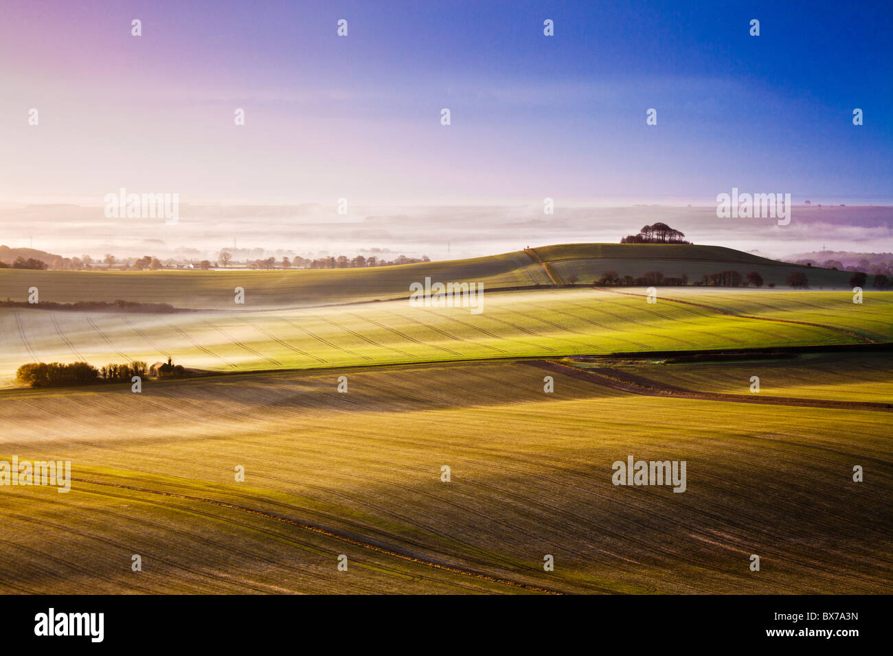 Misty autumn sunrise from Knapp Hill over the Vale of Pewsey in Wiltshire, England, UK - Stock Image