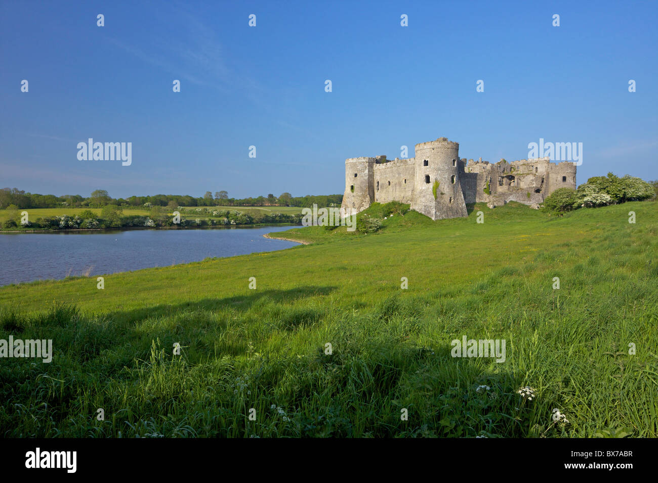 Carew ruined castle in spring sunshine, Pembrokeshire National Park, West Wales,Wales, United Kingdom, Europe - Stock Image