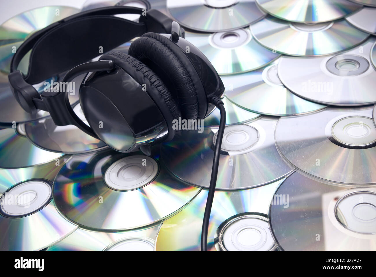 black headphones and lots of CDs Stock Photo