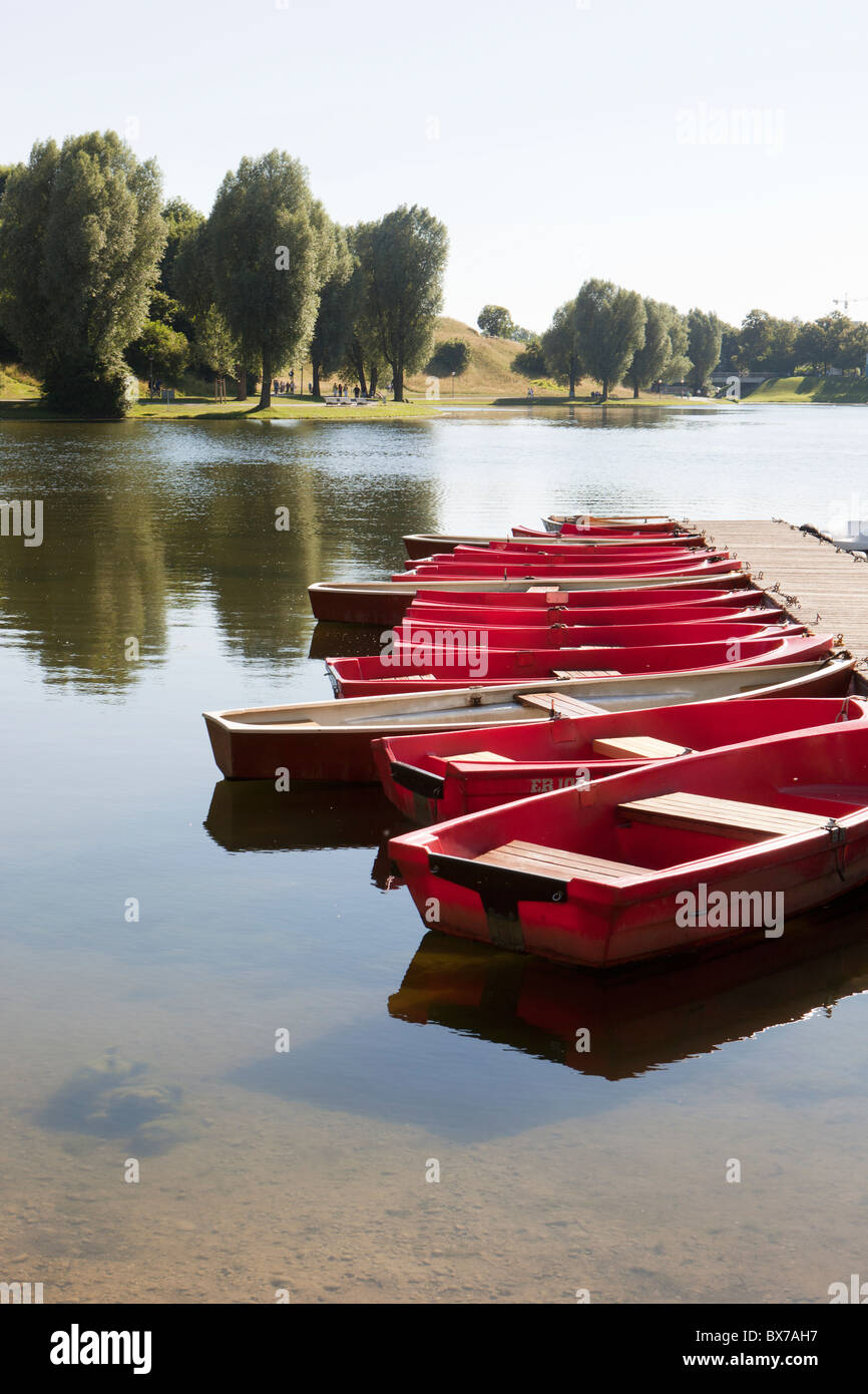 Small boats tied on a jetty - Stock Image