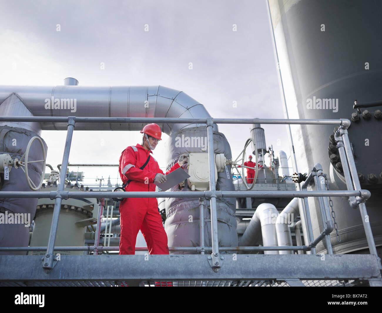 Workers on underground gas storage plant - Stock Image