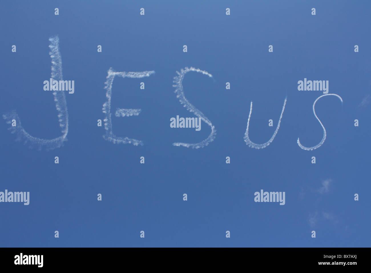 Bi-plane sky writing 'Jesus' - Stock Image