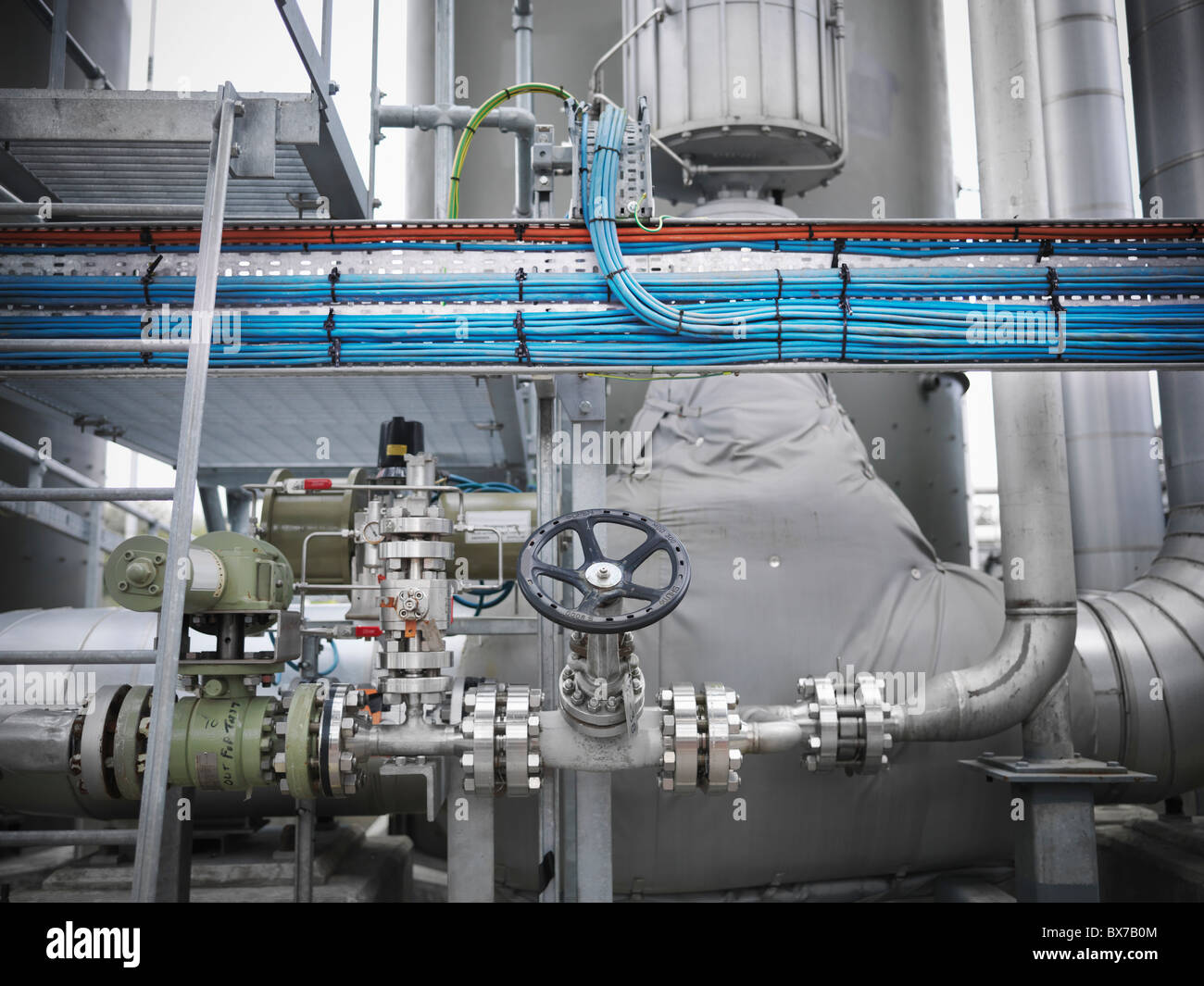 Valves and pipes at gas storage plant - Stock Image
